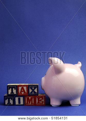 Pink Piggy Bank With Tax Time Message On Building Blocks For Tax Day Or End Of Financial Year Financ