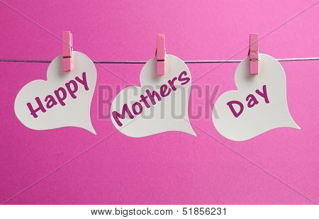 Happy Mothers Day Message Greeting Written Acorss White Heart Tags Hanging From Pink Pegs On A Line