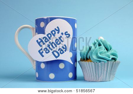 Happy Fathers Day Special Treat Blue And White Beautiful Decorated Cupcakes With Message On Blue Bac
