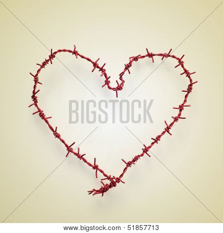 heart-shaped roll of barbed wire on a beige background, with a retro effect
