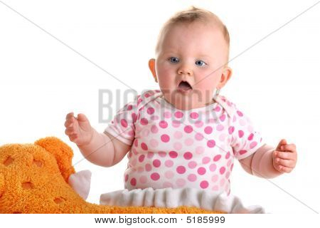 Sweet baby girl with orange plush toy isolated with shadow