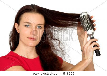 Beautiful Female Model Combing Her Hair
