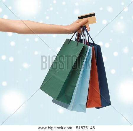 shopping, sale, gifts, christmas, x-mas concept - woman with shopping bags and credit card