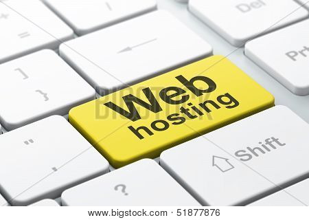 SEO web development concept: Web Hosting on computer keyboard ba
