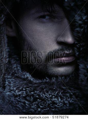 Portrait of a man wearing hood
