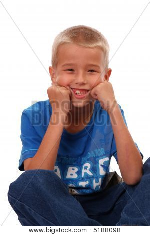 Boy Sitting And Smiling