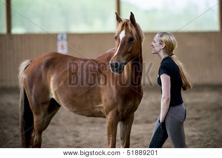 young woman angry about her horse (in joke)