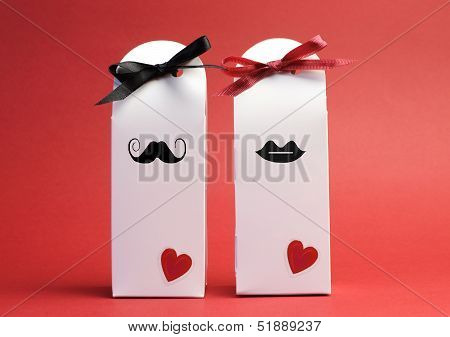 His And Hers Romantic White Valentine Gift Boxes Against A Red Background.