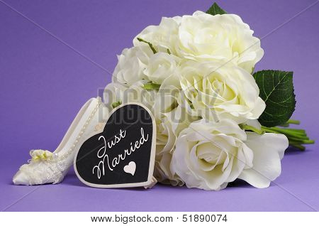 Wedding Bouquet Of White Roses With Good Luck High Heel Shoe And Heart Sign With Just Married Messag