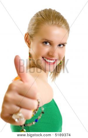 Portrait Of An Attractive Young Girl Making Her Ok Sign