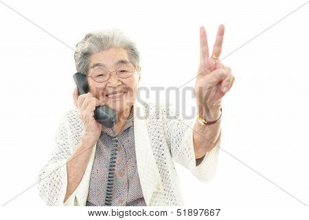 Old woman with phone