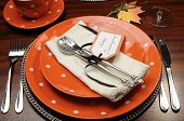 stock photo of thursday  - Beautiful Autumn Fall theme Thanksgiving dinner table place setting with Happy Thanksgiving tag attached to silverware - JPG