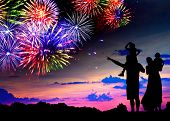 pic of boy girl shadow  - Parents with two children watching fireworks at sunset - JPG