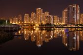 foto of inlet  - Condominiums reflect in the calm waters of False Creek at night - JPG