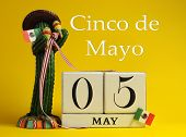 foto of cactus  - Save the date white block calendar for Cinco de May May 5 with fun Mexican cactus and flags against a yellow background - JPG