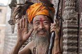 stock photo of blessed  - Holy man in Bhaktapur giving blessing showing the palms - JPG