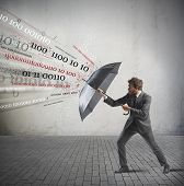 pic of antivirus  - Antivirus and firewall concept with businessman and umbrella - JPG