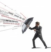 stock photo of antivirus  - Antivirus and firewall concept with businessman and umbrella - JPG