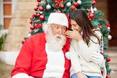 stock photo of nicholas  - Shocked Santa Claus listening to girl - JPG
