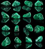 picture of malachite  - Collection set of malachite mineral stone close up  with reflection on black surface background - JPG
