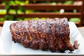 picture of ribs  - grilled pork ribs on a white dish - JPG