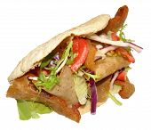 stock photo of pita  - A takeaway doner kebab in a pita bread - JPG