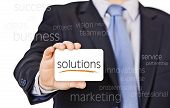 stock photo of courtesy  - businessman offer solutions with a business card - JPG