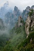 pic of grotesque  - Grotesque Rocks on foggy Mt - JPG