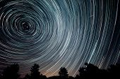 stock photo of meteor  - beautiful dark sky at night with startrails - JPG