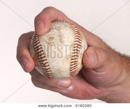 Man Holding Baseball Isolated On White