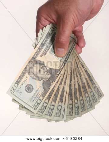 Hand Holding A Stack Of $20 Bills