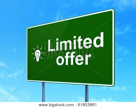 Business concept: Limited Offer and Light Bulb on road sign background