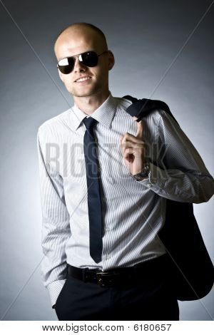 Young Businessman With Coat On Shoulder
