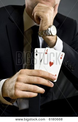 Businessman Holding Two Aces