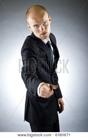Business Man Pointing At The Camera