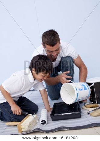 Man And Little Boy Painting A Bedroom