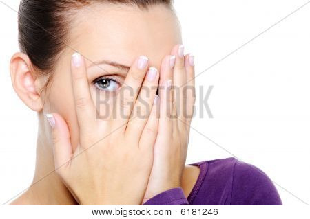 Woman Hide Her Face And Watch Through Fingers