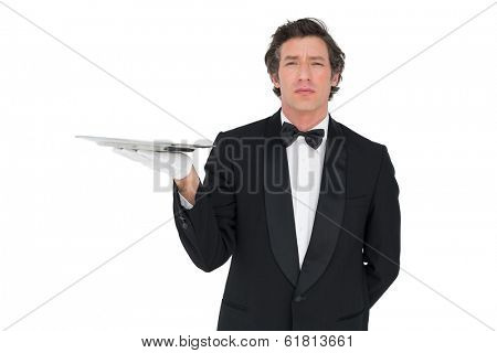Portrait of server with attitude holding tray against white background