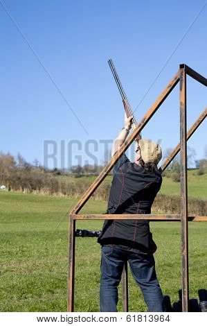 Clay Shooter In Stand Aiming At The Clay