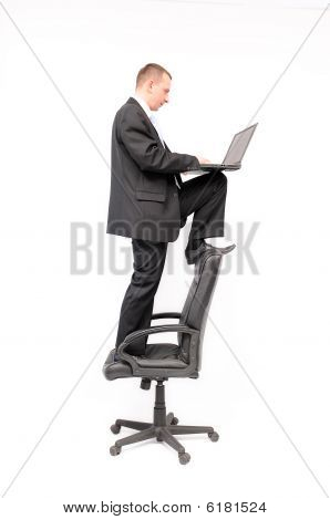 Man on a chair with notebook