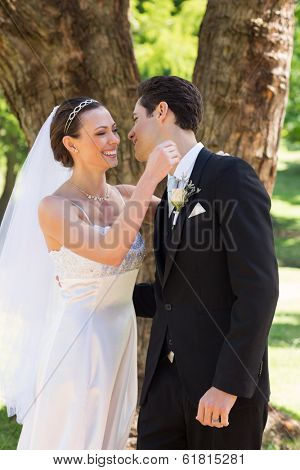 Happy newly wed couple about to hug in garden