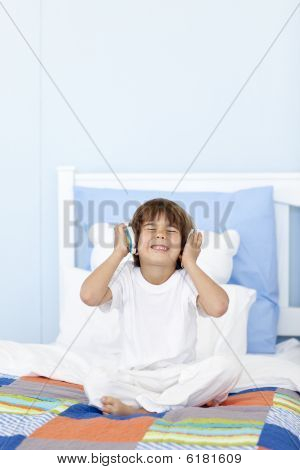 Little Boy Listening To Music On Headphones