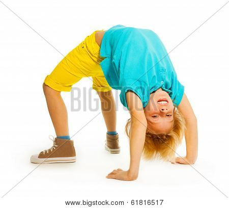 Happy boy showing acrobatic trick