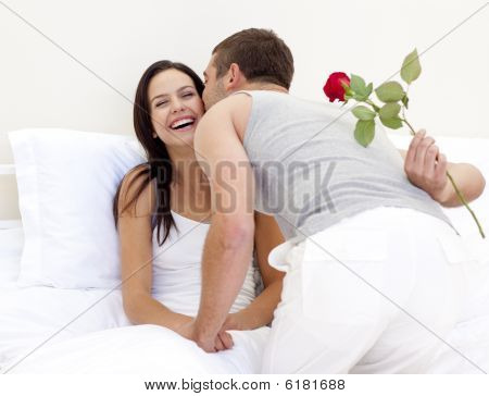 Man Giving A Rose And A Kiss