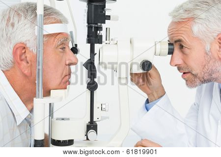 Close-up of an optometrist doing sight testing for senior patient