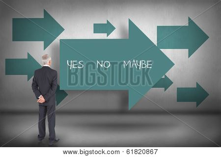 The word yes no maybe and rear view of mature businessman posing against blue arrows pointing