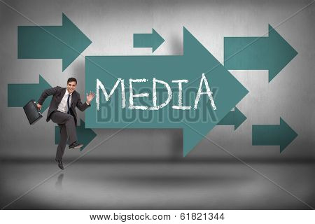 The word media and happy businessman in a hury against blue arrows pointing