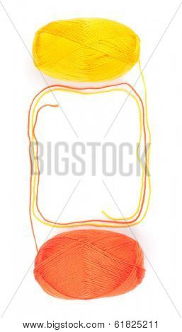 yarn skeins in orange and yellow colors on white background
