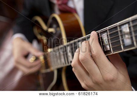 Jazz guitarist playing a chord
