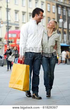 Loving couple with shopping bags in the city